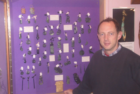Ian with a fine selection of whalebone and jade pendants